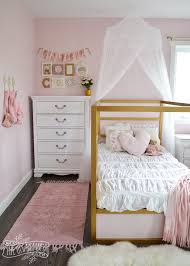 a shabby chic glam girls bedroom design idea in blush pink white