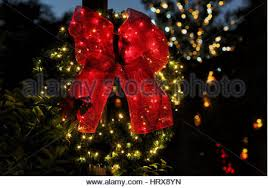 large lighted christmas bow a lighted christmas wreath on a holiday display on the island of