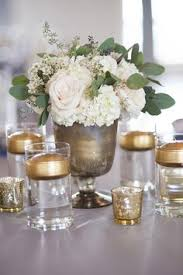 gold votives white flowers baby breath gypsohila tables