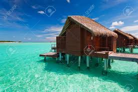 over water bungalow with steps into amazing lagoon stock photo
