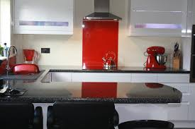 a bright red acrylic kitchen splashback with a high gloss finish