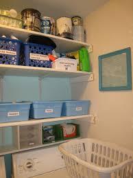 house room laundry organization with white plastic laundry basket