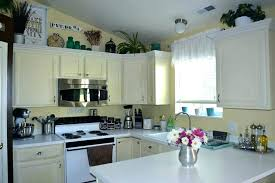 decorating ideas for kitchen cabinet tops cabinet top decor best above kitchen cabinets ideas on above
