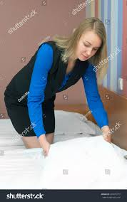 room service woman making bed hotel stock photo 470475779