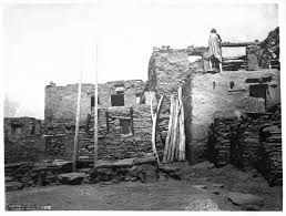 Adobe House File Hopi Indian Woman On Top Of Her Adobe House As She Enlarges