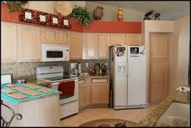 Painting Wooden Kitchen Cabinets by Delighful Brown Painted Kitchen Cabinets With White Appliances