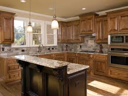 light brown paint colors with white trim in kitchen with dark