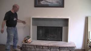 stone fireplace mantel leather chair warmth living room nuance