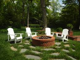 the fire pit adirondack chairs provide comfortable seating around the fire pit