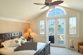 ceiling fan crown molding foyer crown molding bedroom tropical with window blinds leather