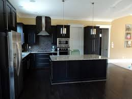 espresso kitchen cabinets with wood floors wonderful home security