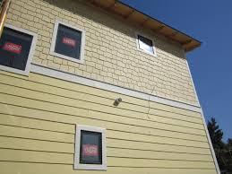 siding green button homes