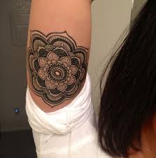 cute little black ink mandala flower tattoo for girls on upper arm