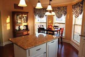 interior cream bay window treatments kitchen with grey marble