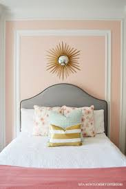 the headboard makes for a nice contrast against the pale peach