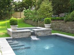 spa spill over pool contemporary with waterfall round fire bowls