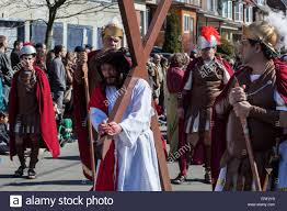 jesus carrying the cross surrounded by roman soldiers easter