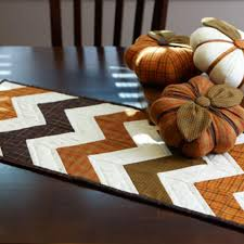 free thanksgiving quilt patterns stitch a fall theme table runner and trio of stuffed pumpkins that
