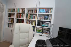 empatika combined home library and office space in one spare room
