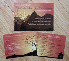 mountain wedding invitations sitting a fall tree overlooking a mountain range