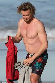 blond hair actor in the mentalist in the swim of it shirtless simon baker puts his scar on show as
