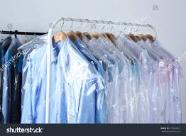 rack clean clothes hanging on hangers stock photo 617024093