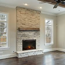 living room stone chimney black brass fireplace screen red