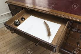 parchment writing paper vintage set with quill and ink pot on top of parchment paper