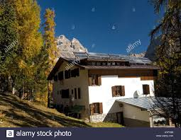 chalet style solar panels on alpine chalet style building in italian dolomites