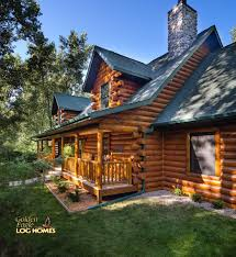 log home by golden eagle log homes exterior 2 rear road side