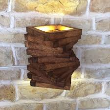 abstract rustic handmade wood wall light spiral up wall