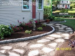 front yard landscape construction project with garden path stone