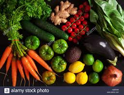 colorful fruits and vegetables on black background dieting