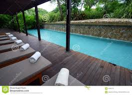 blue spa resort poolside chaise lounges stock photography image