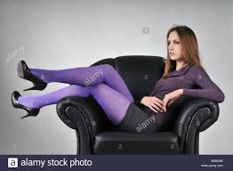 Big Armchair Portrait Of Young Woman With Violet Pantyhose Sitting In Big