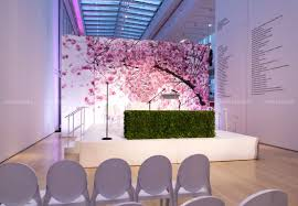 gigantic cherry blossoms on a printed backdrop for a summer themed