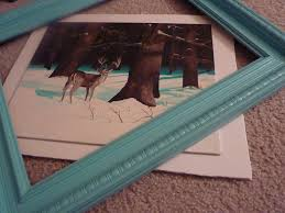 framing a flat canvas in which another deer gallops its way into