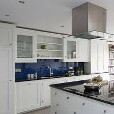 white kitchen ideas uk loving the blue glass backsplash in this white kitchen