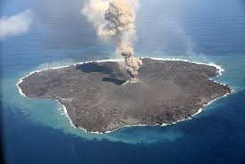 magma and lava from volcanic eruption create new landmass south of