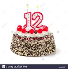 birthday cake with burning candle number 12 stock photo royalty