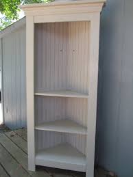 bookcases corner units tall white wooden corner shelf with triple shelves in two