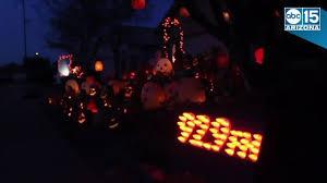 phoenix homeowner creates stunning halloween themed light display