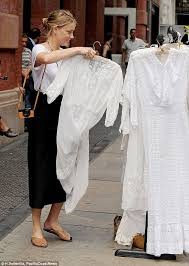 amber heard peruses vintage inspired white frocks at a street