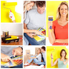 smiling couple choosing color for the interior wall of home stock