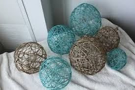 decorative yarn balls made from balloons paper mache as