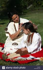free mative american braids for hair photos a native american indian woman braiding her childs hair stock