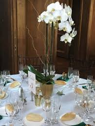 orchid centerpieces black white and gold tablescape with orchid centerpieces the big