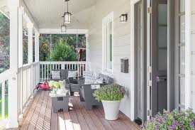 modern gray porch swing with gray chevron pillows transitional