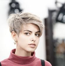 short hairstyles with feathered sides messy layered pixie with side swept bangs pixies short hair