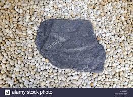 zen garden fragment big stone on detailed small pebbles